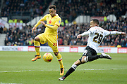 MK Dons striker Nicky Maynard battles with Derby County defender Marcus Olsson during the Sky Bet Championship match between Derby County and Milton Keynes Dons at the iPro Stadium, Derby, England on 13 February 2016. Photo by Jon Hobley.