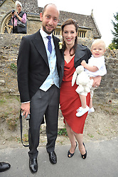 HUGO & the HON.FLORA RYCROFT and their son NELSON at the wedding of Lohralee Stutz and the Hon.William Astor at St.Augustine's Church, East Hendred, Oxfordshire on 5th September 2009.