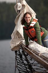 United States, Washington, San Juan Islands, young woman (19 years) on sailboat