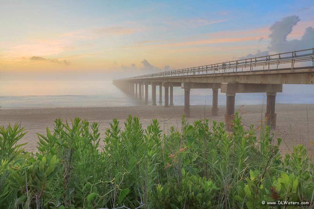Foggy sunrise at the Duck Research Pier on the Outer Banks, NC.