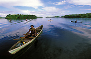 Samuel - fishing from a dugout canoe on Vona Vona Lagoon - The Solomon Islands