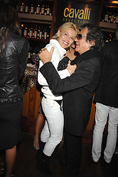 DIANA JENKINS and ROBERTO CAVALLI at a party to celebrate the launch of Cavalli Selection - the first ever wine from Casa Cavalli, held at 17 Berkeley Street, London W1 on 29th May 2008.<br />