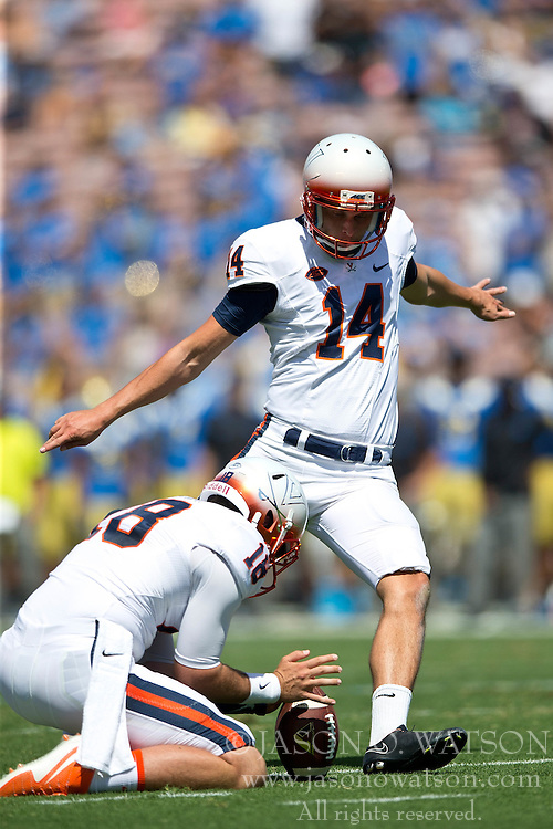 PASADENA, CA - SEPTEMBER 05:  Place kicker Ian Frye #14 of the Virginia Cavaliers kicks a field goal on a hold from Nicholas Conte #18 during the second quarter against the UCLA Bruins at the Rose Bowl on September 5, 2015 in Pasadena, California. The UCLA Bruins defeated the Virginia Cavaliers 34-16. (Photo by Jason O. Watson/Getty Images) *** Local Caption *** Ian Frye; Nicholas Conte