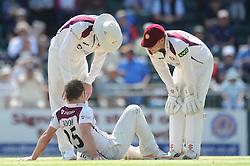 Steven Crook of Northamptonshire goes down injured - Photo mandatory by-line: Dougie Allward/JMP - Mobile: 07966 386802 - 09/07/2015 - SPORT - Cricket - Cheltenham - Cheltenham College - LV=County Championship 2