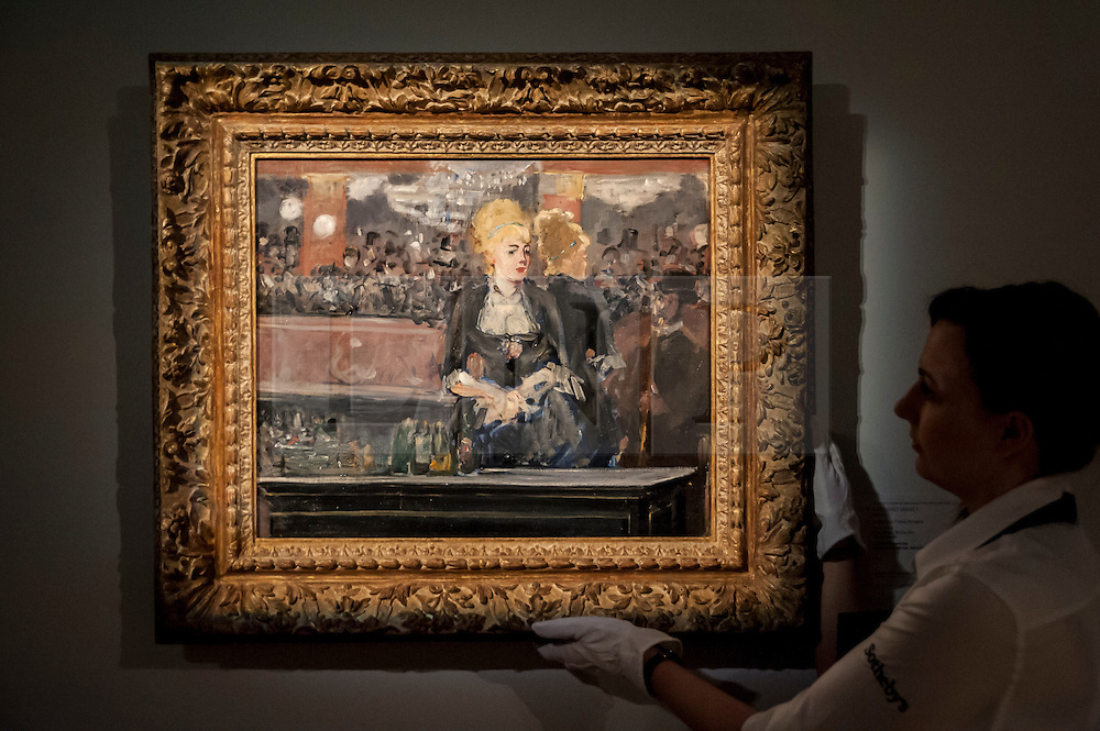 """© Licensed to London News Pictures. 19/06/2015. London, UK. A Sotheby's staff member shows Edouard Manet's """"Le Bar aux Folies-Bergère"""" (est. £15-£20m), at Sotheby's Impressionist, Modern & Contemporary Art preview, ahead of the sale on 24 June 2015. Leading the sale are Kazimir Malevich's, """"Suprematism, 18th Construction"""" and Edouard Manet's """"Le Bar aux Folies-Bergère"""".  Photo credit : Stephen Chung/LNP"""