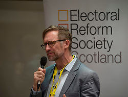 Pictured: Willie Sullivan from the Electoral Reform Society Scotland speaks to a fringe meeting at the conference discussing citizen's assemblies.<br /> <br /> The SNP held their spring conference at the EICC in Edinburgh, where independence and brevet were high on the agenda.<br /> <br /> © Dave Johnston / EEm