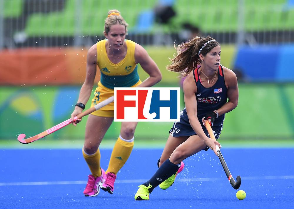 Australia's Edwina Bone looks on as yhe USA's Katie Reinprecht controls the ball during the womens's field hockey Australia vs USA match of the Rio 2016 Olympics Games at the Olympic Hockey Centre in Rio de Janeiro on August, 8 2016. / AFP / MANAN VATSYAYANA        (Photo credit should read MANAN VATSYAYANA/AFP/Getty Images)