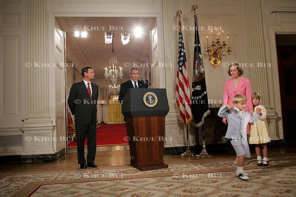 John (Jack) Roberts, son of the nominee, dances as Pres. Bush announces his Supreme Court nominee John Roberts in the State Dining Room of the White House Tuesday, July 19, 2005.  Also shown are Roberts's wife Jane Sullivan Roberts and daughter Josephine (Josie)..Photo by Khue Bui