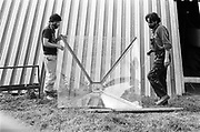 Men holding what was the top of the Pyramid Stage, Glastonbury, Somerset, 1989