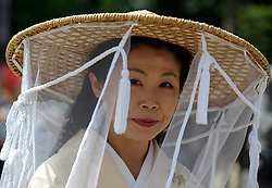 © Licensed to London News Pictures. 19/06/2012. Ascot, UK  A Japanese woman wear a traditional outfit and hat. Day one at Royal Ascot 19 June 2012. Royal Ascot has established itself as a national institution and the centrepiece of the British social calendar as well as being a stage for the best racehorses in the world.. Photo credit : Stephen Simpson/LNP