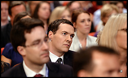 Image ©Licensed to i-Images Picture Agency. 28/09/2014. Birmingham, United Kingdom. Chancellor of the Exchequer George Osborne listening to the Leader of the House of Commons William Hague deliver his last speech to the  Conservative Party Conference.Picture by Andrew Parsons / i-Images