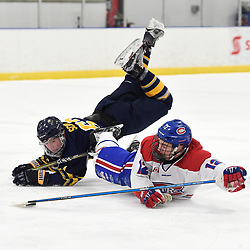 TORONTO, ON  - JAN 7,  2018: Ontario Junior Hockey League game between the Toronto Jr. Canadiens and the Buffalo Jr. Sabres, Jeremy Smith #12 of the Toronto Jr. Canadiens battles for the puck with Michael Sciore #63 of the Buffalo Jr. Sabres during the first period.<br /> (Photo by Andy Corneau / OJHL Images)