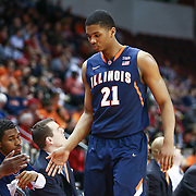 Malcolm Hill #21 of the Illinois Fighting Illini is greeted by his teammates on the bench during the NIT First Round game at Agganis Arena on March 19, 2014 in Boston, Massachusetts . (Photo by Elan Kawesch)