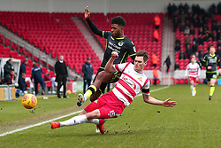 Joe Wright of Doncaster Rovers tackles Ellis Harrison of Bristol Rovers - Mandatory by-line: Robbie Stephenson/JMP - 27/01/2018 - FOOTBALL - The Keepmoat Stadium - Doncaster, England - Doncaster Rovers v Bristol Rovers - Sky Bet League One