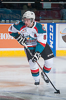 KELOWNA, CANADA - DECEMBER 30: Colten Martin #8 of Kelowna Rockets skates with the puck against the Prince George Cougars on December 30, 2014 at Prospera Place in Kelowna, British Columbia, Canada.  (Photo by Marissa Baecker/Shoot the Breeze)  *** Local Caption *** Colten Martin;