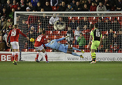 Yeovil Town's Chris Dunn pulls off a fantastic save from Barnsley's Jason Scotland - Photo mandatory by-line: Matt Bunn/JMP - Tel: Mobile: 07966 386802 14/12/2013 - SPORT - Football - Barnsley - Oakwell - Barnsley v Yeovil Town - Sky Bet Championship