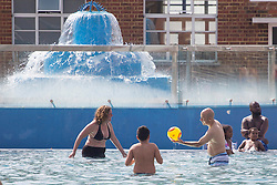© licensed to London News Pictures. London, UK 26/08/2013. People and children enjoying the hot weather on bank holiday on Monday, 26 August, 2013 at Parliament Hill Lido swimming pool in London. Photo credit: Tolga Akmen/LNP