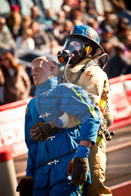 A woman firefighter drags a 175-pound mannequin backwards wearing full firefighting gear and working against the clock during the international finals of the Firefighter Combat Challenge on November 18, 2011 in Myrtle Beach, South Carolina.