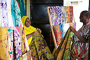 Salma Likupila (left) talking to a customer in her shop near Picha ya Ndege in Tanzania.<br /> <br /> Salma set up and now runs a Batik business, making and selling Batik as well as towels and bed linen.<br /> <br /> She attended MKUBWA enterprise training run by the Tanzania Gatsby Trust in partnership with The Cherie Blair Foundation for Women.