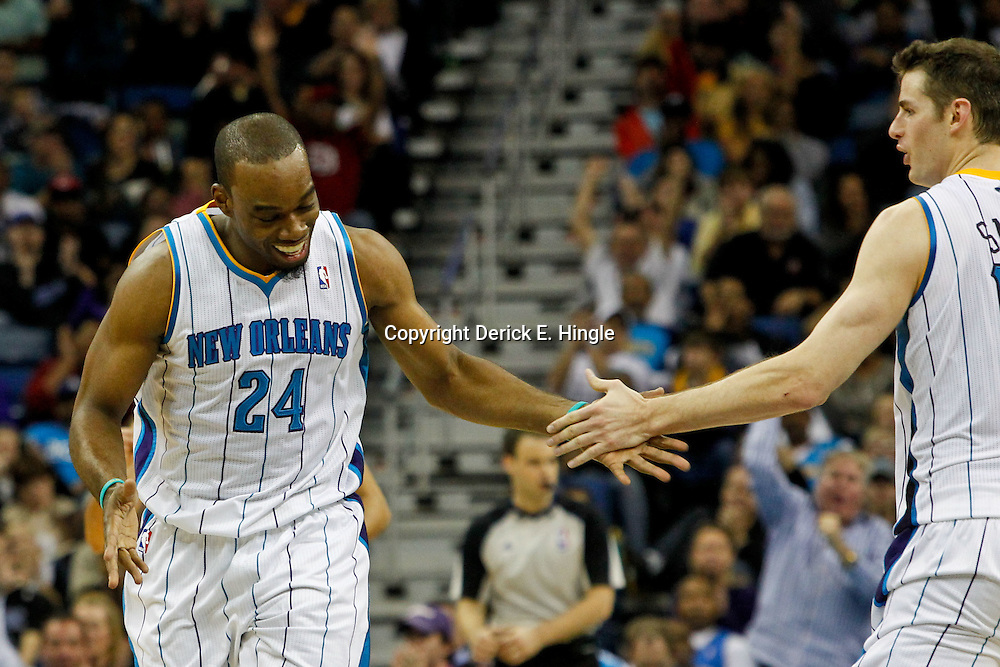 January 27, 2012; New Orleans, LA, USA; New Orleans Hornets power forward Carl Landry (24) celebrates with power forward Jason Smith (14) after a basket against the Orlando Magic during the second half of a game at the New Orleans Arena. The Hornets defeated the Magic 93-67.  Mandatory Credit: Derick E. Hingle-US PRESSWIRE
