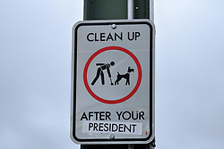 """A modified sign reads """"Clean Up After Your President"""" on the Hawthorne Bridge in Portland, Ore., on October 19, 2017. (Photo by Alex Milan Tracy)"""