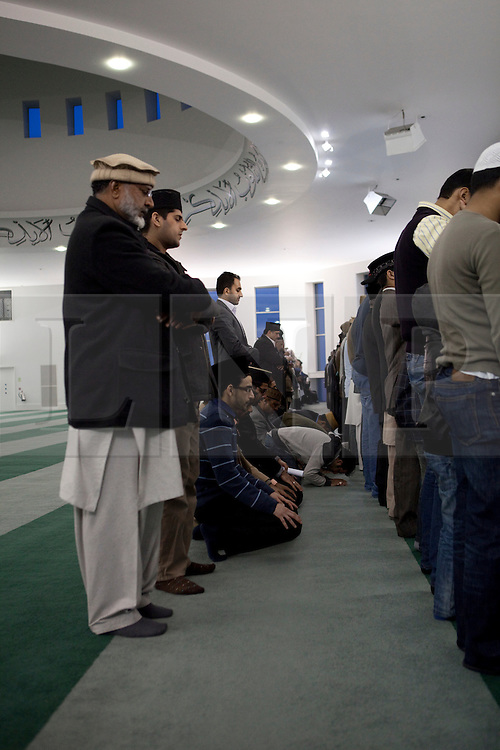 © Licensed to London News Pictures. 24/03/2012. Surrey, U.K..Evening prayers at Europe's largerst mosque, Baitul Futuh Mosque, in Morden, Surrey, which holds 10,000 worshipers. .Parliamentarians and religious, civic, charitable and community leaders meet here this evening 24/3/2012 for a National Peace Symposium on International Peace organised by the Ahmadiyya Muslim community to hear how Muslims are countering extremism..Photo credit : Rich Bowen/LNP