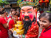 "19 FEBRUARY 2015 - BANGKOK, THAILAND:  Chinese deities solicit donations during a Chinese New Year parade on Yaowarat Road in Bangkok. 2015 is the Year of Goat in the Chinese zodiac. The Goat is the eighth sign in Chinese astrology and ""8"" is considered to be a lucky number. It symbolizes wisdom, fortune and prosperity. Ethnic Chinese make up nearly 15% of the Thai population. Chinese New Year (also called Tet or Lunar New Year) is widely celebrated in Thailand, especially in urban areas that have large Chinese populations.   PHOTO BY JACK KURTZ"