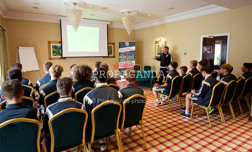 NEWPORT, WALES - Sunday, November 1, 2015: Wales' head coach Osian Roberts at a team meeting before the Under-16's Victory Shield International match against Scotland. (Pic by David Rawcliffe/Propaganda)