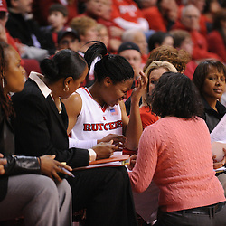 Jan 31, 2009; Piscataway, NJ, USA; Rutgers guard Khadijah Rushdan (1) has her eye checked by Rutgers athletic trainer Lori Uretsky during the second half of South Florida's 59-56 victory over Rutgers in NCAA women's college basketball at the Louis Brown Athletic Center
