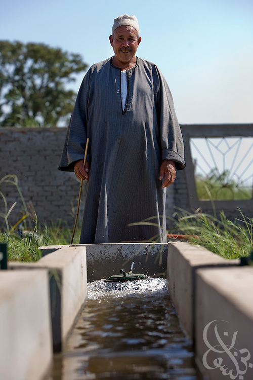 An Egyptian farmer looks over irrigation systems at an irrigation training center in the Egyptian Delta August 5, 2008 near the town of Sakha. Egypt uses an estimated 80% of its' total available fresh water for purposes of irrigation, so improving the efficiency of irrigation methods amongst its' farmers is a top priority. The irrigation training center is operated by a joint cooperative agreement between the Egyptian government and the GTZ (Deutsche Gesellschaft für Technische Zusammenarbeit), a federally owned German company that promotes infrastructure development. .