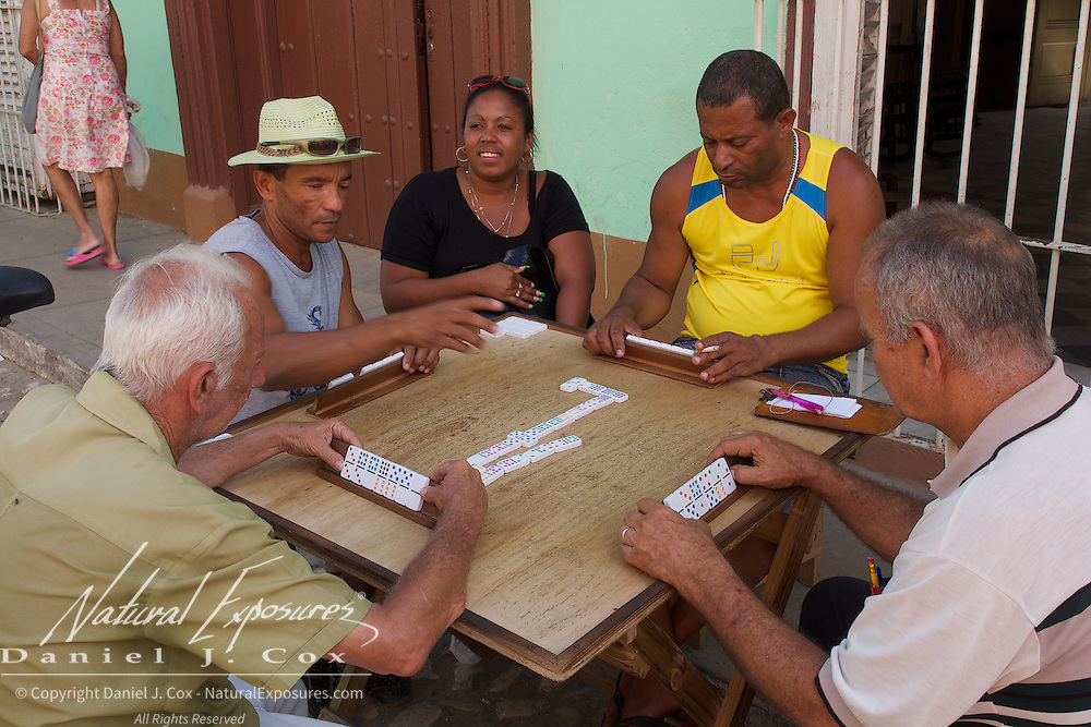 A group of family and friends playing a game on the streets of Trinidad, Cuba.