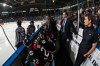 KELOWNA, CANADA - NOVEMBER 28:  Kelowna Rockets' head coach Adam Foote speaks to referee Jeff Ingram on the bench against the Vancouver Giants on November 28, 2018 at Prospera Place in Kelowna, British Columbia, Canada.  (Photo by Marissa Baecker/Shoot the Breeze)