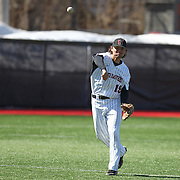 Mike Piscopo #19 of the Northeastern Huskies throws the ball during the game at Friedman Diamond on March 16, 2014 in Brookline, Massachusetts. (Photo by Elan Kawesch)