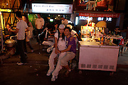 Sanlitun bar street nightlife district. Lovers in front of Pure Girl Bar.