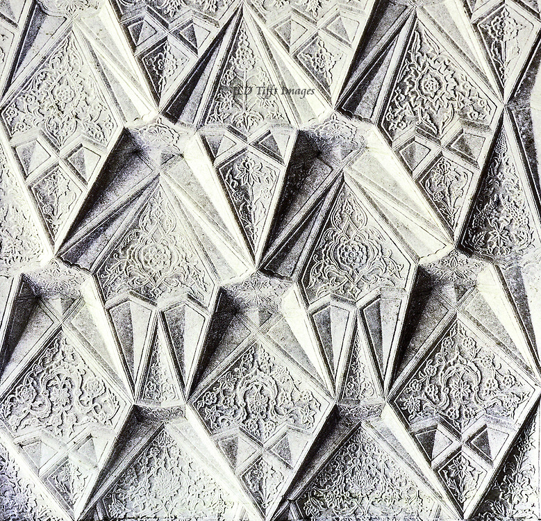 Detail of plaster decoration on a wall of the Itimad ud Daulah tomb, Agra, India, an example of early Mughal stalagtite wall ornament.