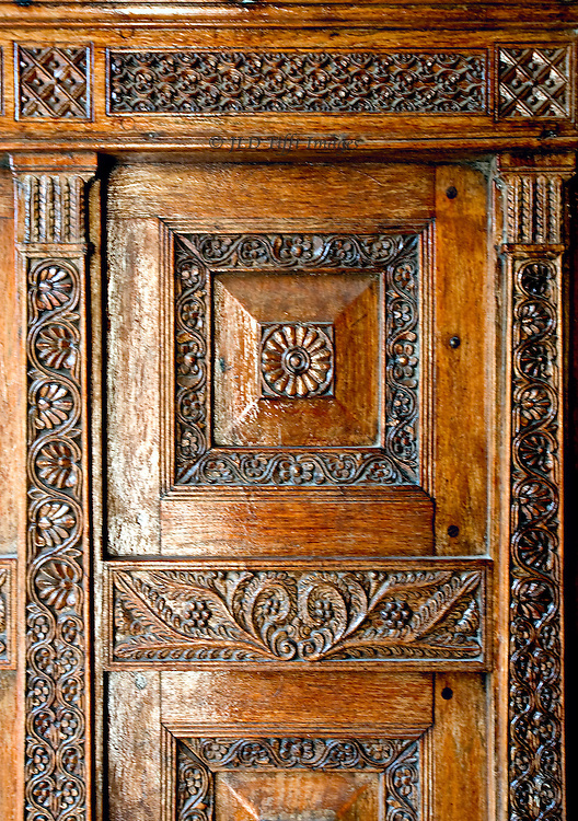 Stonetown carved wooden door in traditional style.