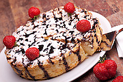 International Cuisine - Desserts - Cheescake with chocolate decorated with strawberries.