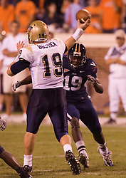 Virginia wide receiver Ras-I Dowling (19) forces Pittsburgh quarterback Pat Bostick (19) to throw, resulting in an interception on the play.  The Virginia Cavaliers defeated the Pittsburgh Panthers 44-14 at Scott Stadium in Charlottesville, VA on September 29, 2007.
