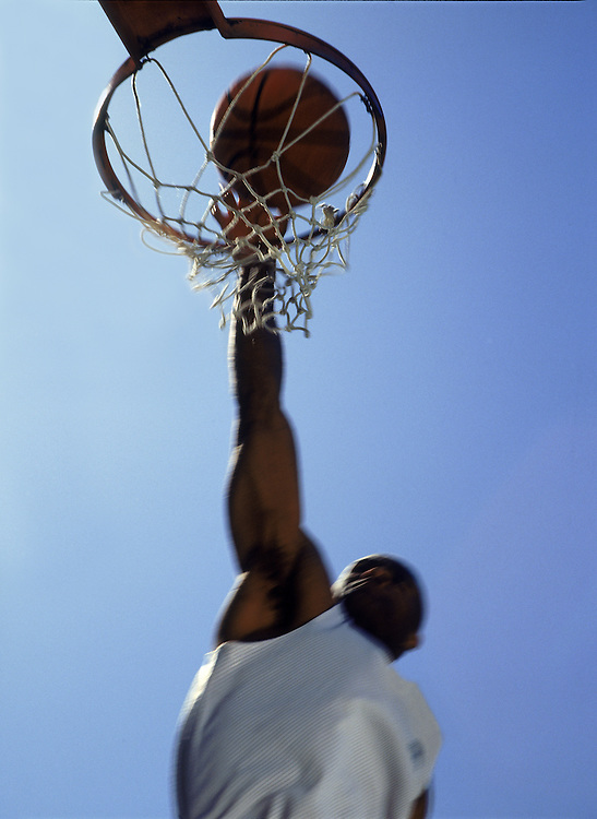 Basketball player makes a slam dunk