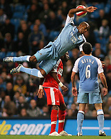 Photo: Paul Thomas.<br /> Manchester City v Middlesbrough. The Barclays Premiership. 30/10/2006.<br /> <br /> Sylvian Distin of Man City goes through the air between Middlesborough's Jason Euell (Red) and team mate Claudio Reyna (6).