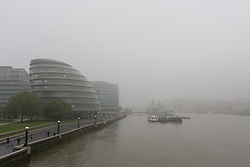 © Licensed to London News Pictures. 11/05/2016. LONDON, UK.  City Hall and HMS Belfast are shrouded in fog during during foggy and wet weather this morning.  Photo credit: Vickie Flores/LNP
