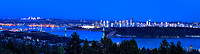 Blue Hour, Vancouver:  Evenings blue cast, over Stanley Park and a downtown skyline, are caught in this panoramic landscape, Vancouver British Columbia Canada.