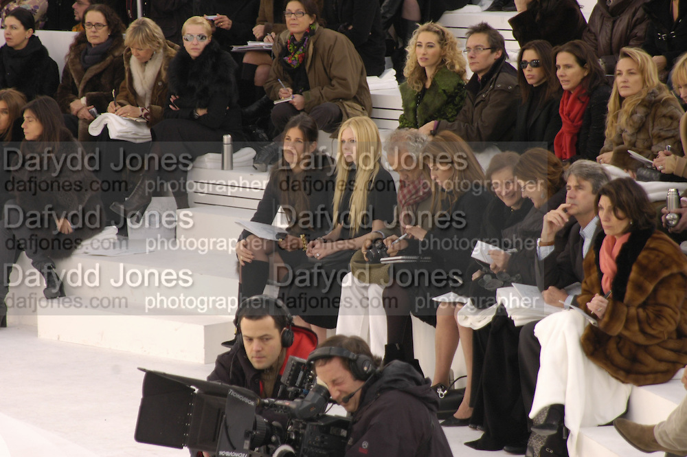 Elizabeth Saltzman and Avril Lavigne, Chanel couture fashion show. Grand Palais, Ave Winston Churchill. Paris. 24  January  2006.  ONE TIME USE ONLY - DO NOT ARCHIVE  © Copyright Photograph by Dafydd Jones 66 Stockwell Park Rd. London SW9 0DA Tel 020 7733 0108 www.dafjones.com