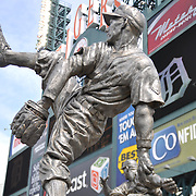 Charlie Gehringer statue at Comerica Park stands approx. 13 ft tall and is cast in stainless steel. It sits on a granite base and stands with 5 other Detroit Tiger Hall of Fame statues.