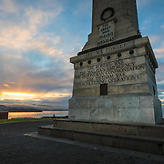 Sunrise at the Cenotaph, the war memorial at the  Domain gardens, Hobart, Tasmania, Australia