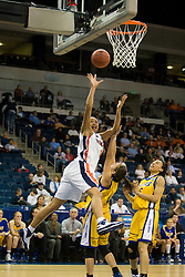 Virginia forward Lyndra Littles (1) shoots over UCSB guard Lauren Pedersen (15).  The #4 seed/#24 ranked Virginia Cavaliers defeated the #13 seed Santa Barbara Gauchos 86-52 in the first round of the 2008 NCAA Division 1 Women's Basketball Championship at the Ted Constant Convocation Center in Norfolk, VA on March 23, 2008