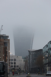 © Licensed to London News Pictures. 18/12/2016. LONDON, UK.  The Walkie Talkie skyscraper in the City of London is seen shrouded in fog this morning. Foggy weather continues to disrupt flights from London airports this morning.  Photo credit: Vickie Flores/LNP LNP