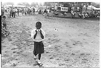 Little black girl with camera at Blackheath fair, London street photography in 1982. Tri-X