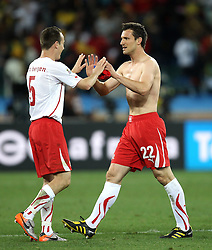 Steve VON BERGEN and  Mario EGGIMANN celebrate after  the 2010 FIFA World Cup South Africa Group H match between Spain and Switzerland at Durban Stadium on June 16, 2010 in Durban, South Africa.