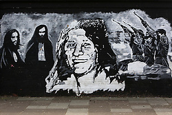 "On a wall in Twinbrook west Belfast, a black and white mural of Bobby Sands and the Hunger Strikers is seen clearly without any mention or graffiti to the death of the former British Prime Minister Margaret Thatcher. Sands a volunteer of the Provisional Irish Republican Army and member of the British Parliament who died on hunger strike while imprisoned in HM Prison Maze on the 5th of May 1981. Margaret Thatcher, then prime minister, had said: ""How can I talk to them [the prisoners] when they have no support, no mandate?"" Yet when Bobby Sands was elected by the people of Fermanagh and South Tyrone, with more votes than Thatcher in Finchley, she became even more intransigent. She refused to negotiate and changed the law to prevent any other prisoner standing for election. Margaret Thatcher passed away on April 8, 2013. Britain stood deeply divided over the legacy of former prime minister Margaret Thatcher as it made preparations for the grand funeral next week of the woman known around the globe as the 'Iron Lady', Belfast, Great Britain, 9th April, 2013.  Photo by Paul McErlane / i-Images. .."